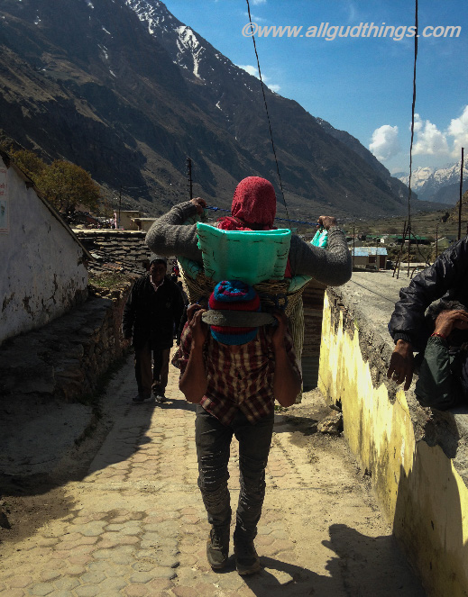Porters carrying Pilgrimages at Mana Village