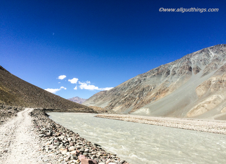 Driving next to river bed in the valley: Lahaul Spiti road trip