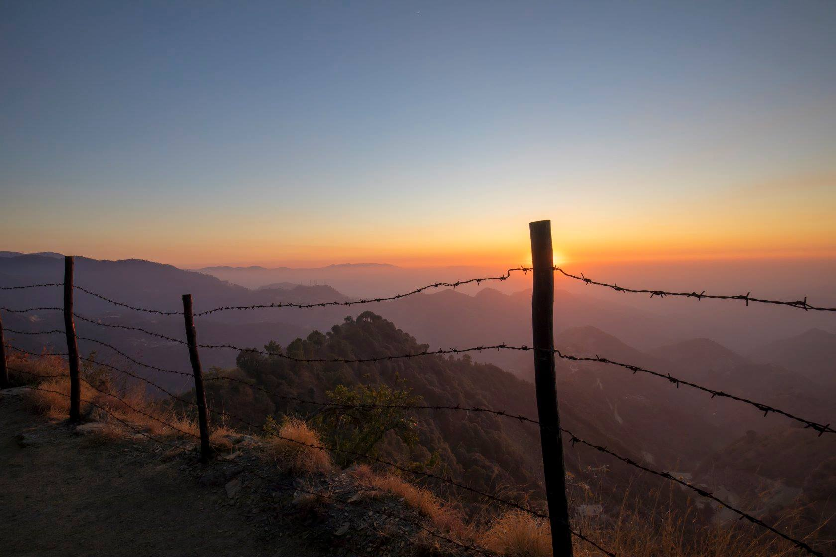 Sunset from The ridge at Aamod Resort Shoghi