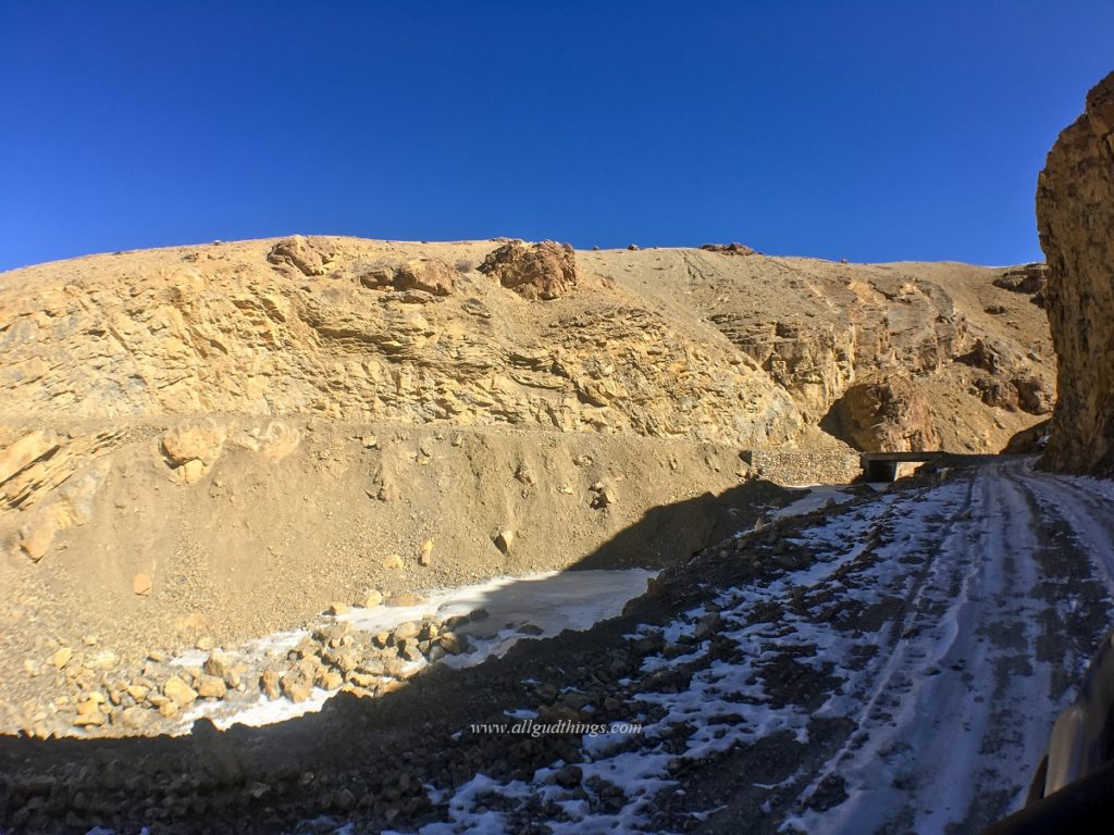 Snow on the road during winter spiti trip